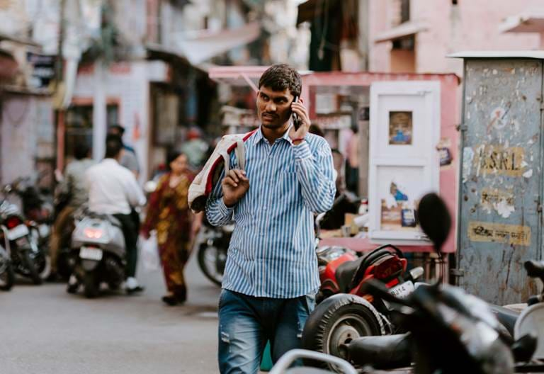 Indian man on phone - landscape. Photo credit: Annie Spratt, Unsplash
